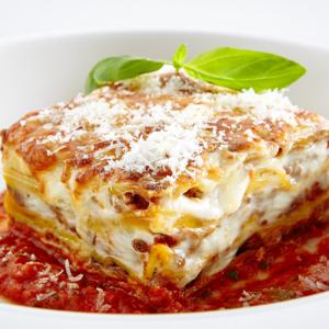 Lasagna layered with ricotta cheese, mozzarella cheese, Romano cheese, Italian sausage and meatballs